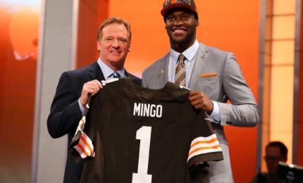NEW YORK, NY - APRIL 25: Barkevious Mingo of the LSU Tigers stands on stage with NFL Commissioner Roger Goodell as they hold up a jersey on stage after Mingo was picked #6 overall by the Cleveland Browns in the first round of the 2013 NFL Draft at Radio City Music Hall on April 25, 2013 in New York City. (Photo by Al Bello/Getty Images)